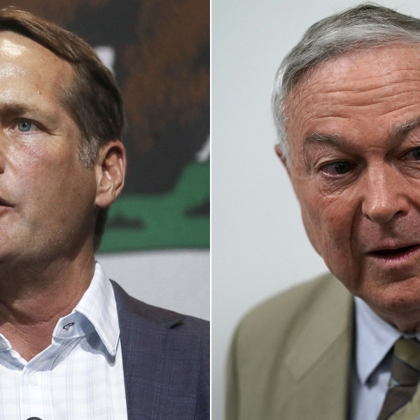 At left, Democratic congressional candidate Harley Rouda speaks at an election rally in Fullerton on Oct. 4, 2018. At right, incumbent GOP Rep. Dana Rohrabacher speaks to the media after leaving a Republican conference meeting on Capitol Hill, June 7, 2018. (Credit: Mario Tama / Alex Wong / Getty Images)