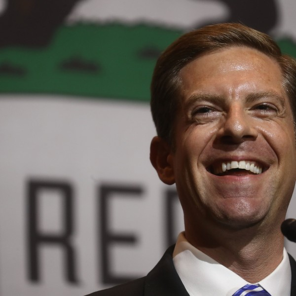 Democratic congressional candidate Mike Levin (CA-49) smiles at a 2018 midterm elections rally on Oct. 4, 2018, in Fullerton. (Credit: Mario Tama/Getty Images)
