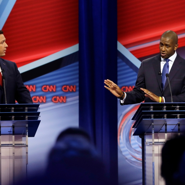 Florida Democratic gubernatorial candidate Andrew Gillum, right, addresses his Florida Republican opponent Ron DeSantis during a CNN debate on Oct. 21, 2018, in Tampa, Florida. (Credit: Chris O'Meara-Pool/Getty Images)
