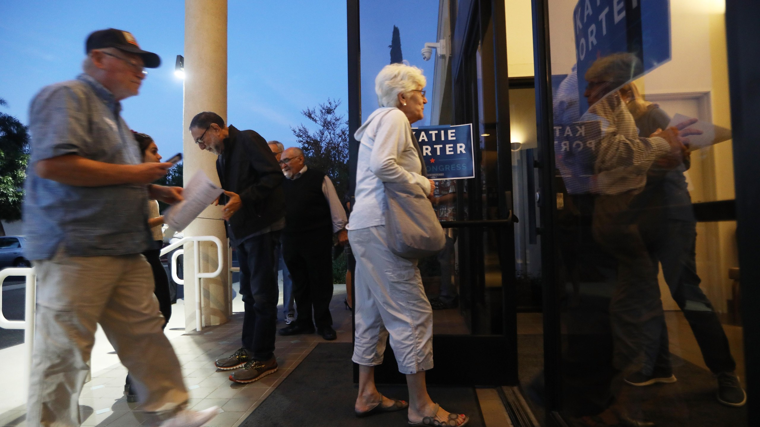 Voters enter before the start of a campaign town hall with Democratic congressional candidate Katie Porter (CA-45) in Tustin on on Oct. 22, 2018. (Credit: Mario Tama/Getty Images)