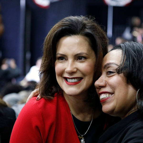 Gretchen Whitmer, left, poses for a photo at a Democratic rally at Detroit Cass Tech High School on Oct. 26, 2018 in Detroit, Michigan. (Credit: Bill Pugliano/Getty Images)