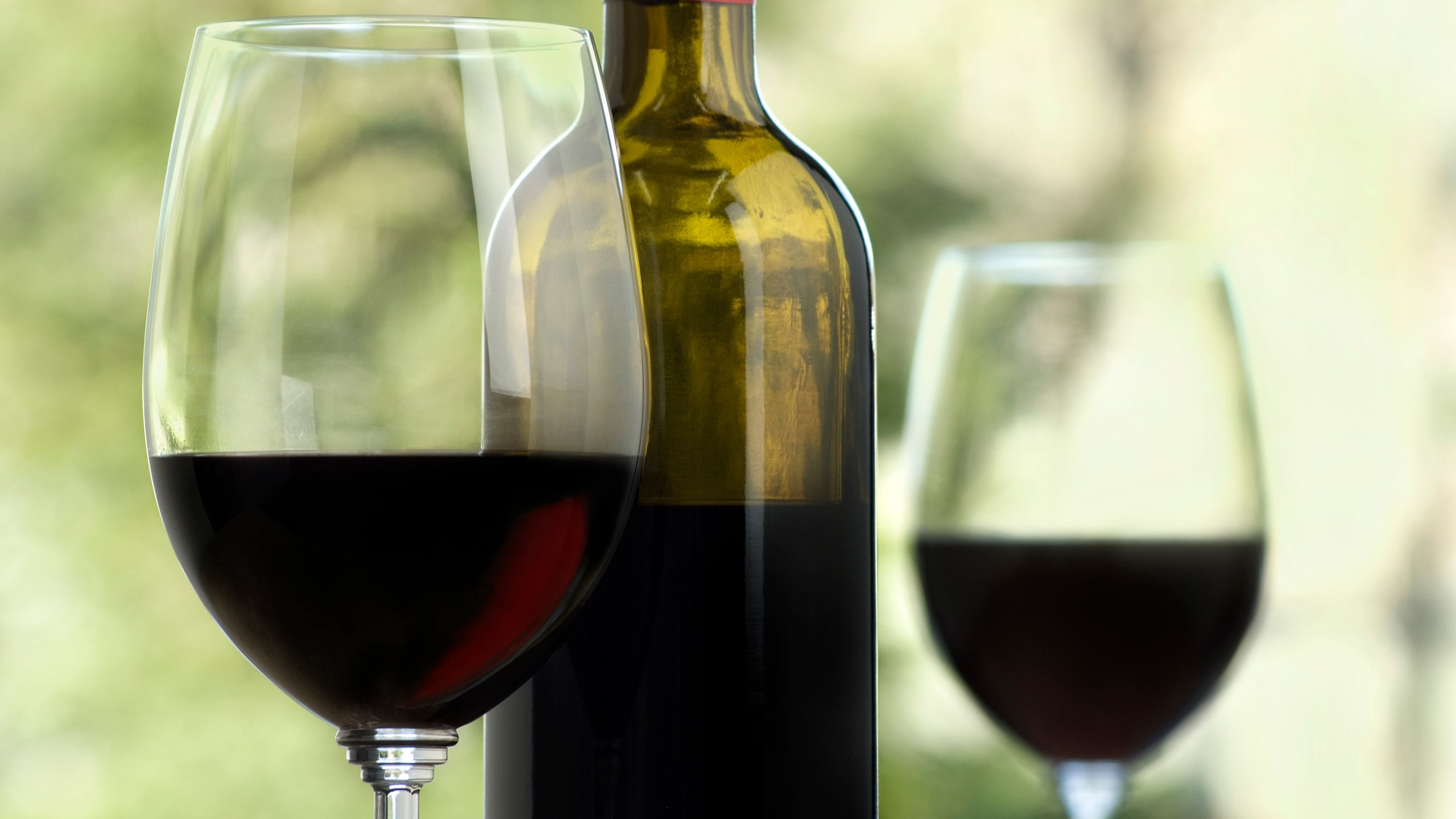 A file photo shows a bottle and two glasses of wine. (Credit: Getty Images)