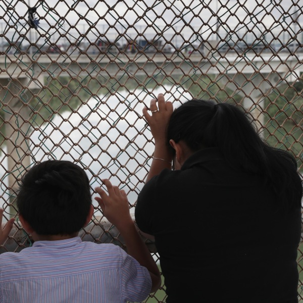 Nicaraguan asylum seekers wait for entry into the United States while on the international bridge on Nov. 4, 2018 in Hidalgo, Texas. (Credit: John Moore/Getty Images)