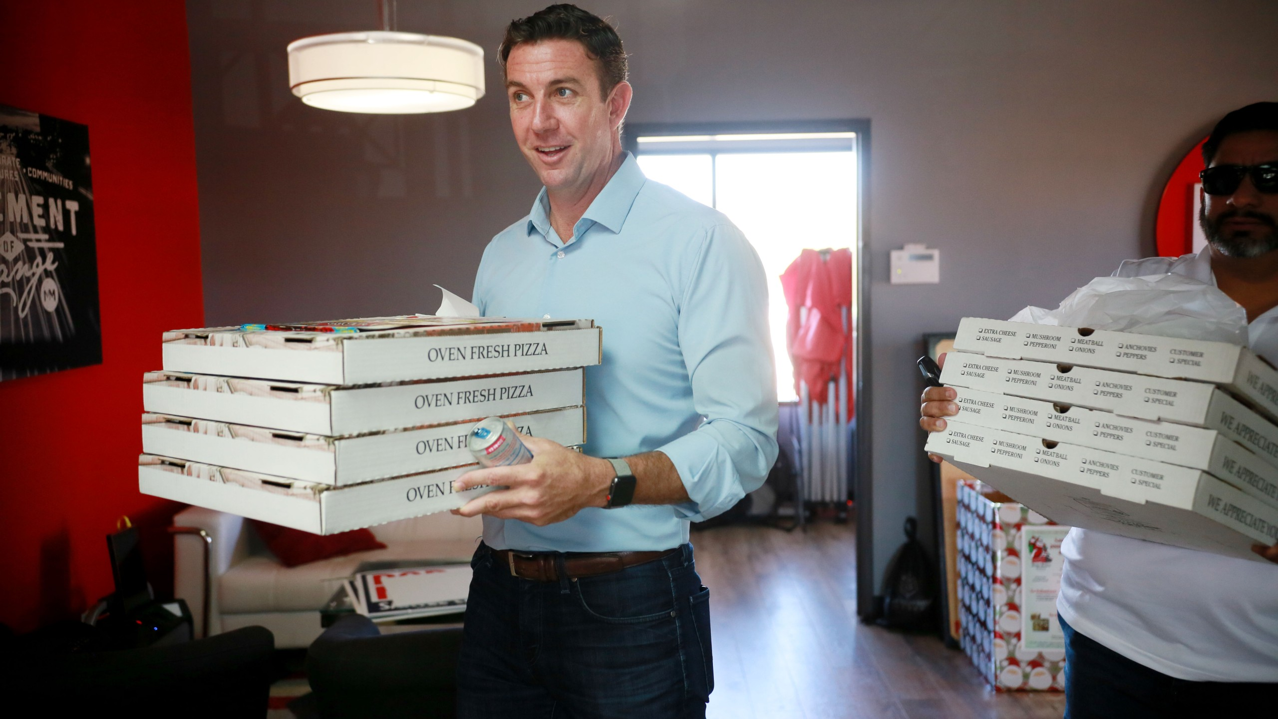 Rep. Duncan Hunter (R-CA) brings pizza to campaign staffers during a visit to one of his headquarters on Nov. 6, 2018, in Santee. (Credit: Sandy Huffaker/Getty Images)