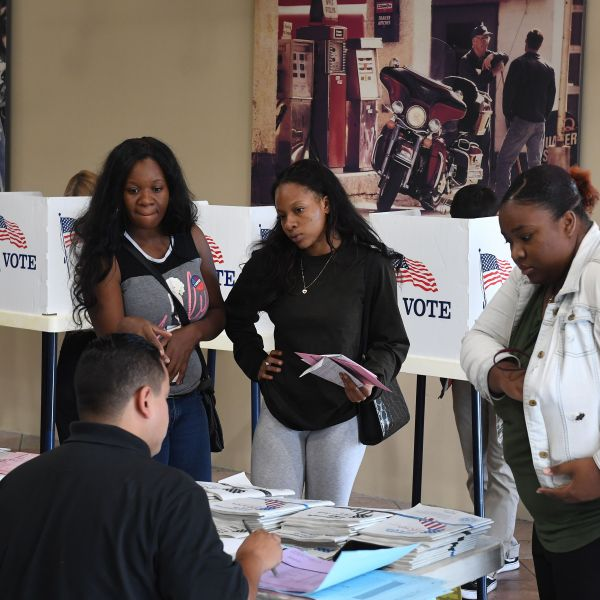 People vote at a Harley-Davidson showroom and polling station in Long Beach during the midterm elections on Nov. 6, 2018. (Credit: Mark Ralston / AFP / Getty Images)