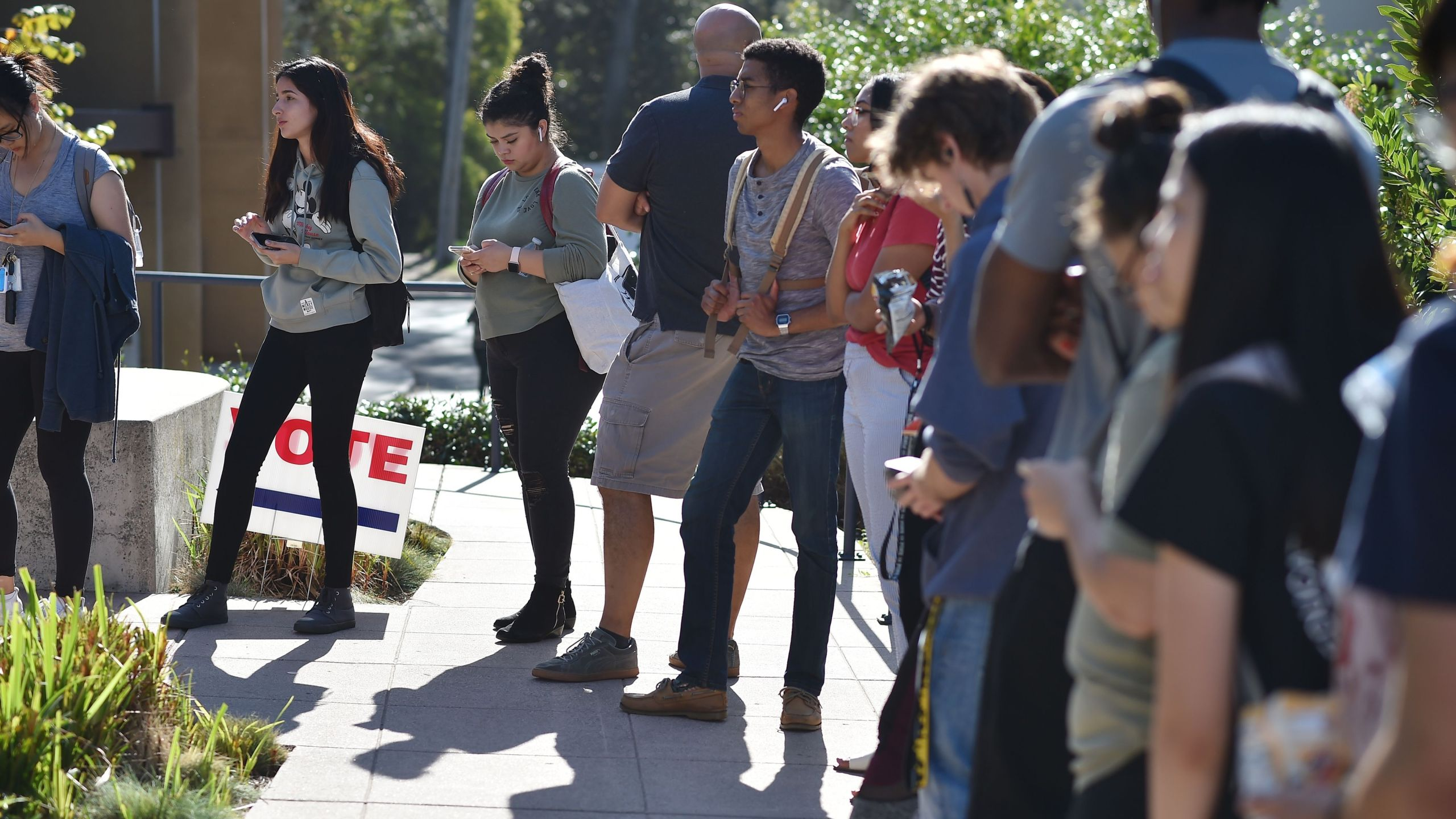 Students wait in line to cast their ballot at a polling station on the campus of UC Irvine on Nov. 6, 2018. (Credit: Robyn Beck / AFP / Getty Images)