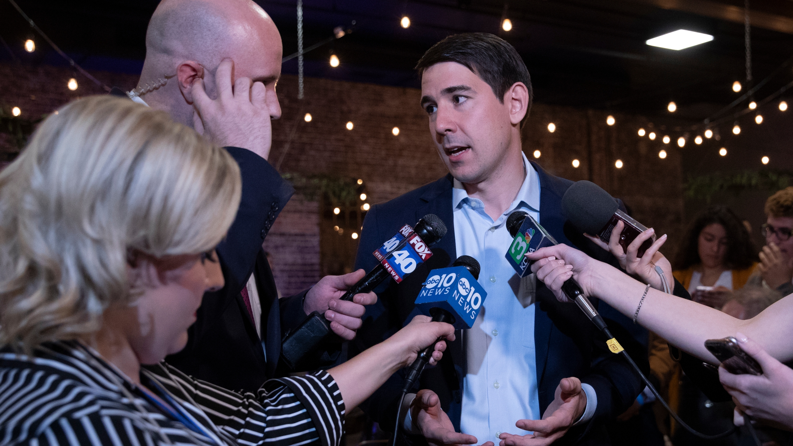 Democratic candidate for California's 10th Congressional District Josh Harder speaks with television reporters during an election night event in Modesto on Nov. 6, 2018. (Credit: Alex Edelman / Getty Images)