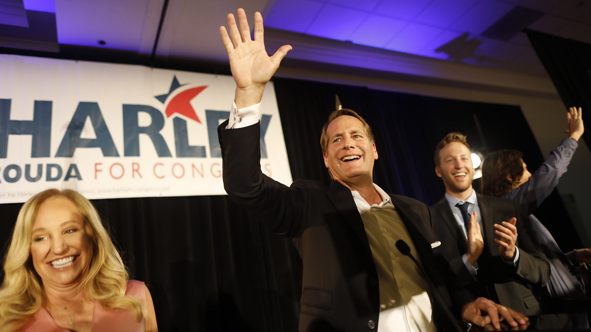 Harley Rouda speaks to supporters with his family during their election day party at the Newport Beach Marriott Hotel and Spa on Nov. 6, 2018, in Newport Beach, California. (Credit: Barbara Davidson/Getty Images)