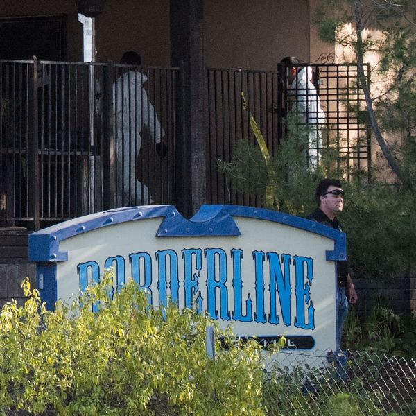 Investigators work at the scene of a mass shooting at the Borderline Bar & Grill in Thousand Oaks, on Nov. 8, 2018. (Credit: Robyn Beck/AFP/Getty Images)