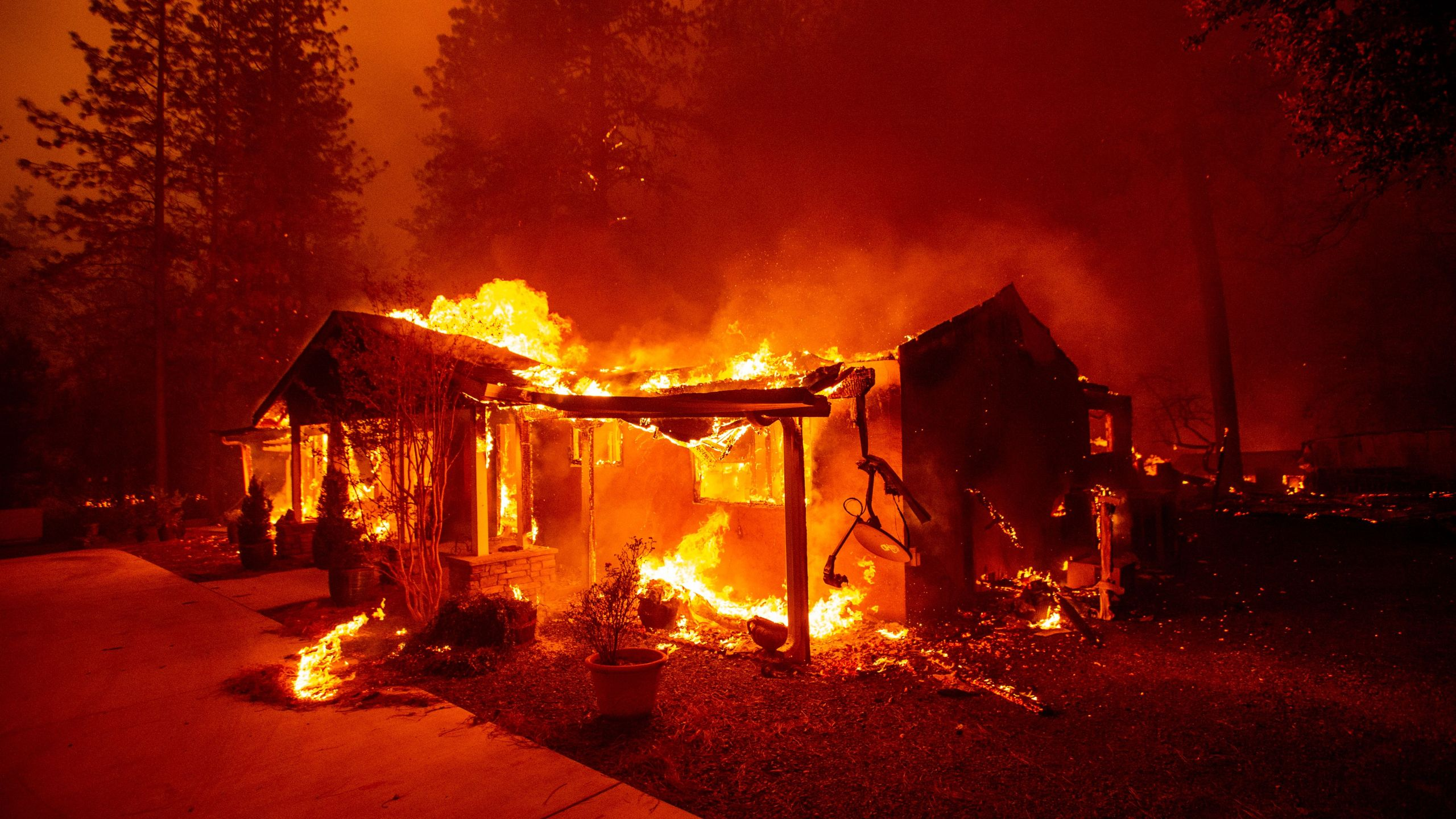A home burns during the Camp fire in Paradise in Northern California on Nov. 8, 2018. (Credit: JOSH EDELSON/AFP/Getty Images)