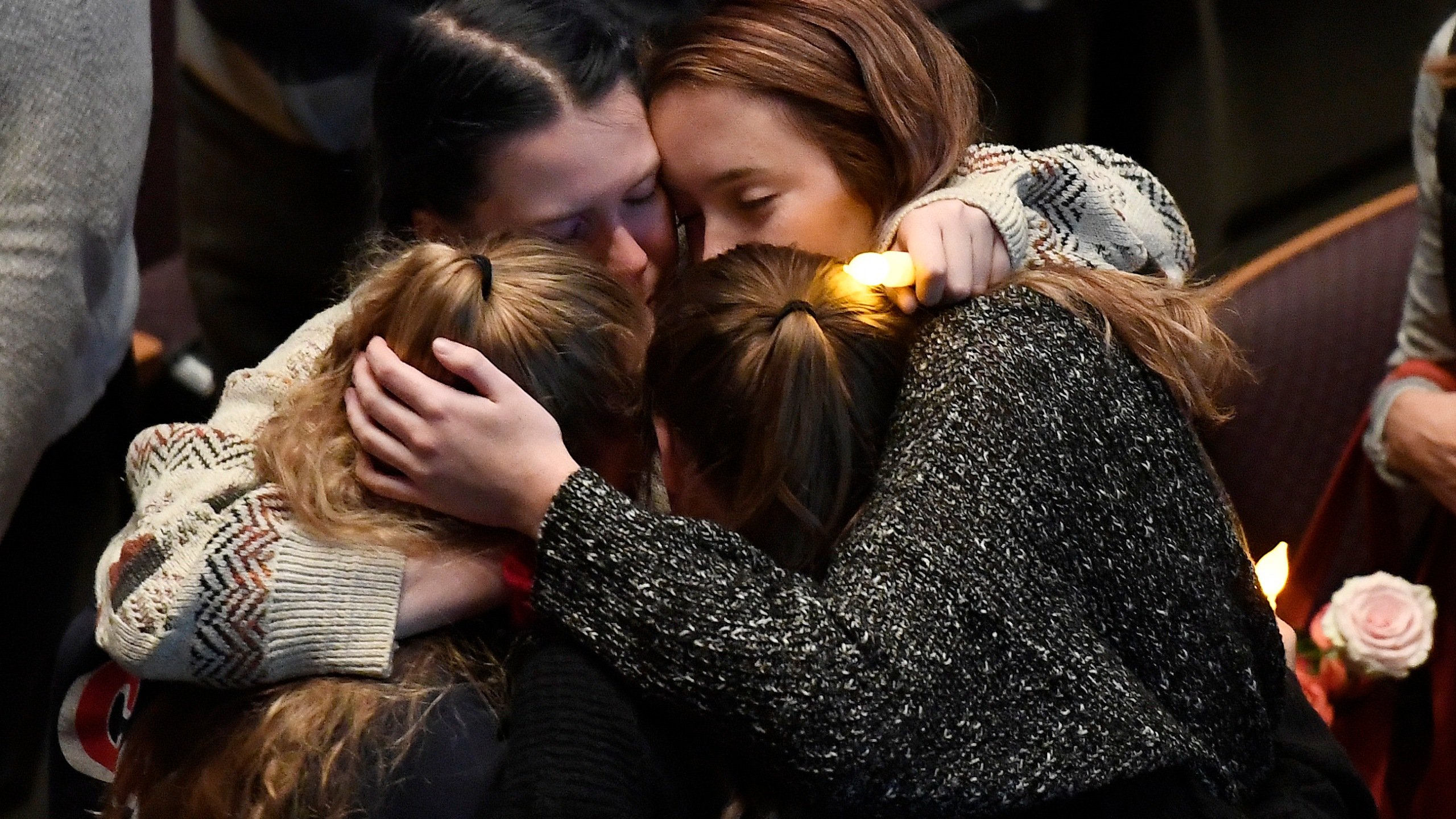 Mourners cry and comfort each other during a vigil for the victims of the mass shooting at the Thousand Oaks Civic Arts Plaza on Nov. 8, 2018, in Thousand Oaks. (Credit: Kevork Djansezian/Getty Images)