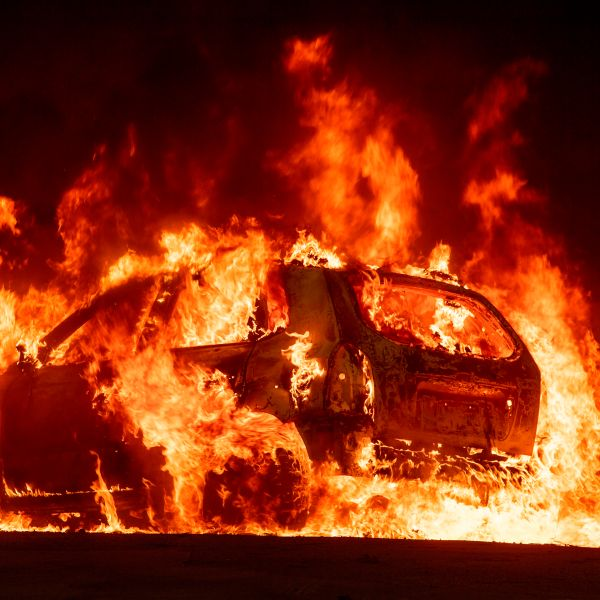 A car explodes into flames as the Camp Fire tears through downtown Paradise, California, on Nov. 8, 2018. (Credit: JOSH EDELSON/AFP/Getty Images)