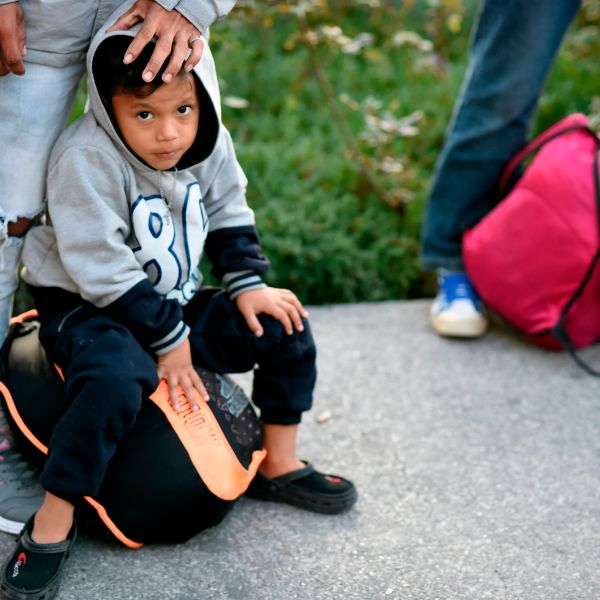 A Central-American migrant child heading in a caravan to the U.S., is pictured outside the Cuatro Caminos metro station in Mexico City, on the way to Queretaro state, on Nov. 9, 2018. (Credit: ALFREDO ESTRELLA/AFP/Getty Images)