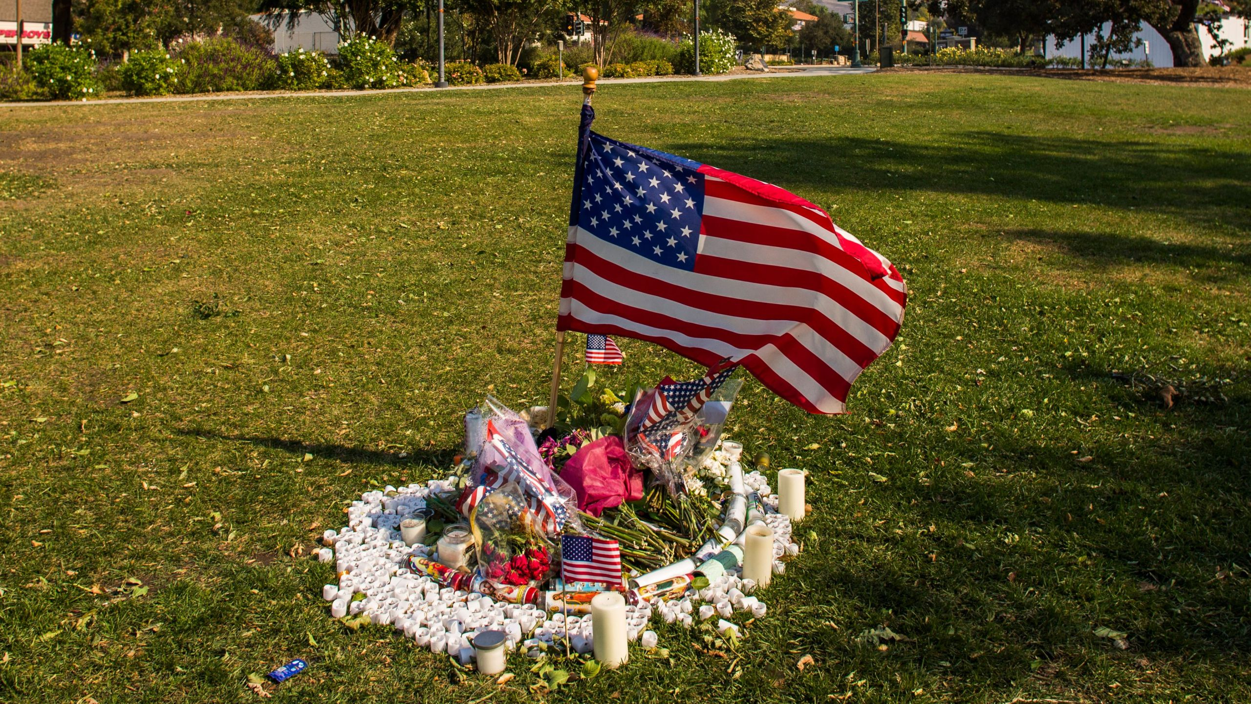 Flowers and candles are left in front of Thousands Oaks City Hall in tribute to the victims of the Borderline Bar & Grill mass shooting in Thousands on November 09, 2018. (Credit: APU GOMES/AFP/Getty Images)