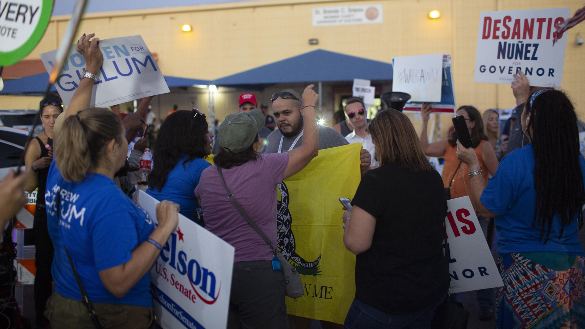 Protesters confront each other outside the Broward County Supervisor of Elections office on Nov. 9, 2018, in Lauderhill, Florida. Both the gubernatorial and Senate races are now heading to a recount. (Credit: Saul Martinez/Getty Images)