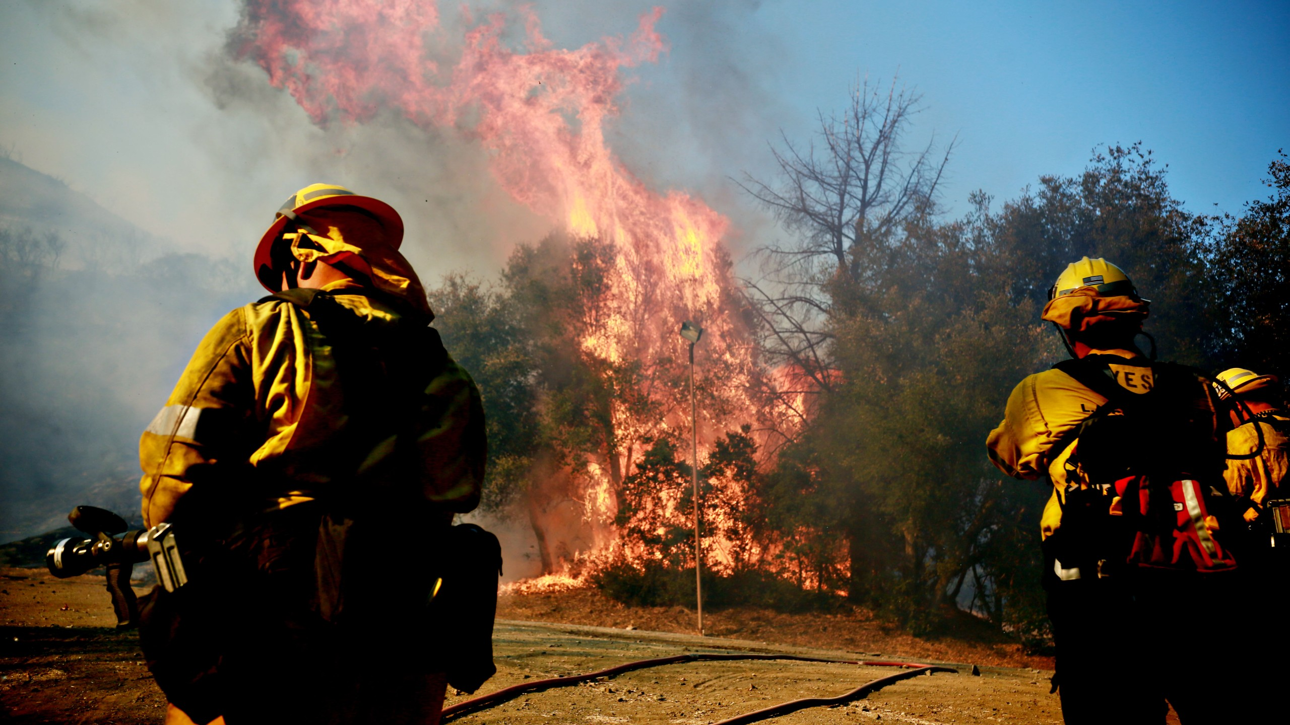 Firefighters battle a blaze at the Salvation Army Camp on Nov. 10, 2018, in Malibu. (Credit: Sandy Huffaker/Getty Images)