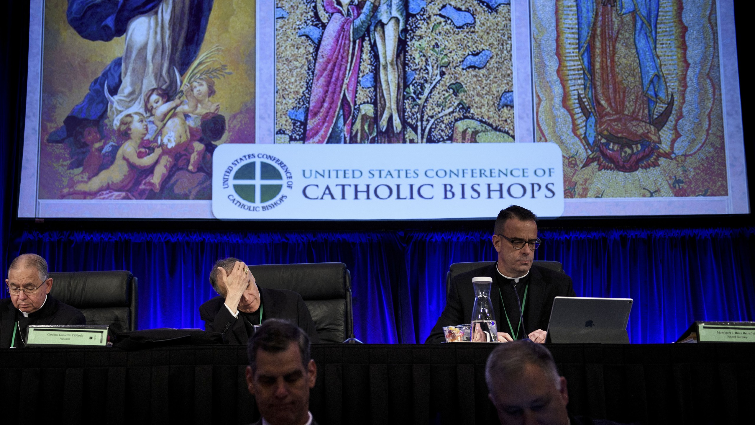 Reverend Jose Gomez (Top L), Archbishop of Los Angeles and Vice President of the USCCB General Assembly, Cardinal Daniel DiNardo (Top C), President of the USCCB General Assembly, and others wait for an opening session during the annual US Conference of Catholic Bishops November 12, 2018 in Baltimore, Maryland. (Credit: BRENDAN SMIALOWSKI/AFP/Getty Images)