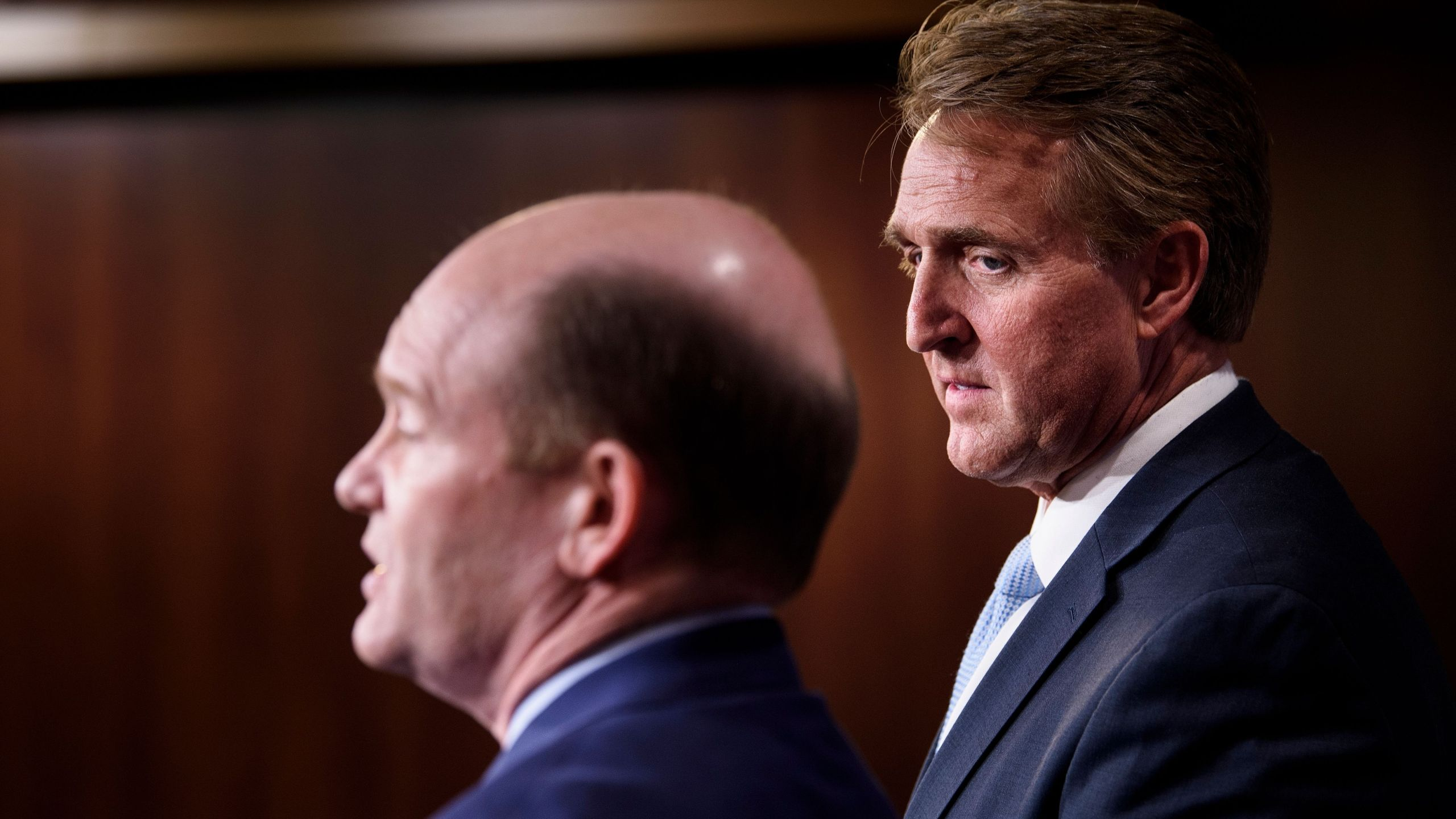 Sen. Jeff Flake (R-AZ), right, and Sen. Christopher A. Coons (D-DE) hold a press conference on legislation to protect the Mueller Investigation on Capitol Hill Nov. 14, 2018. (Credit: BRENDAN SMIALOWSKI/AFP/Getty Images)
