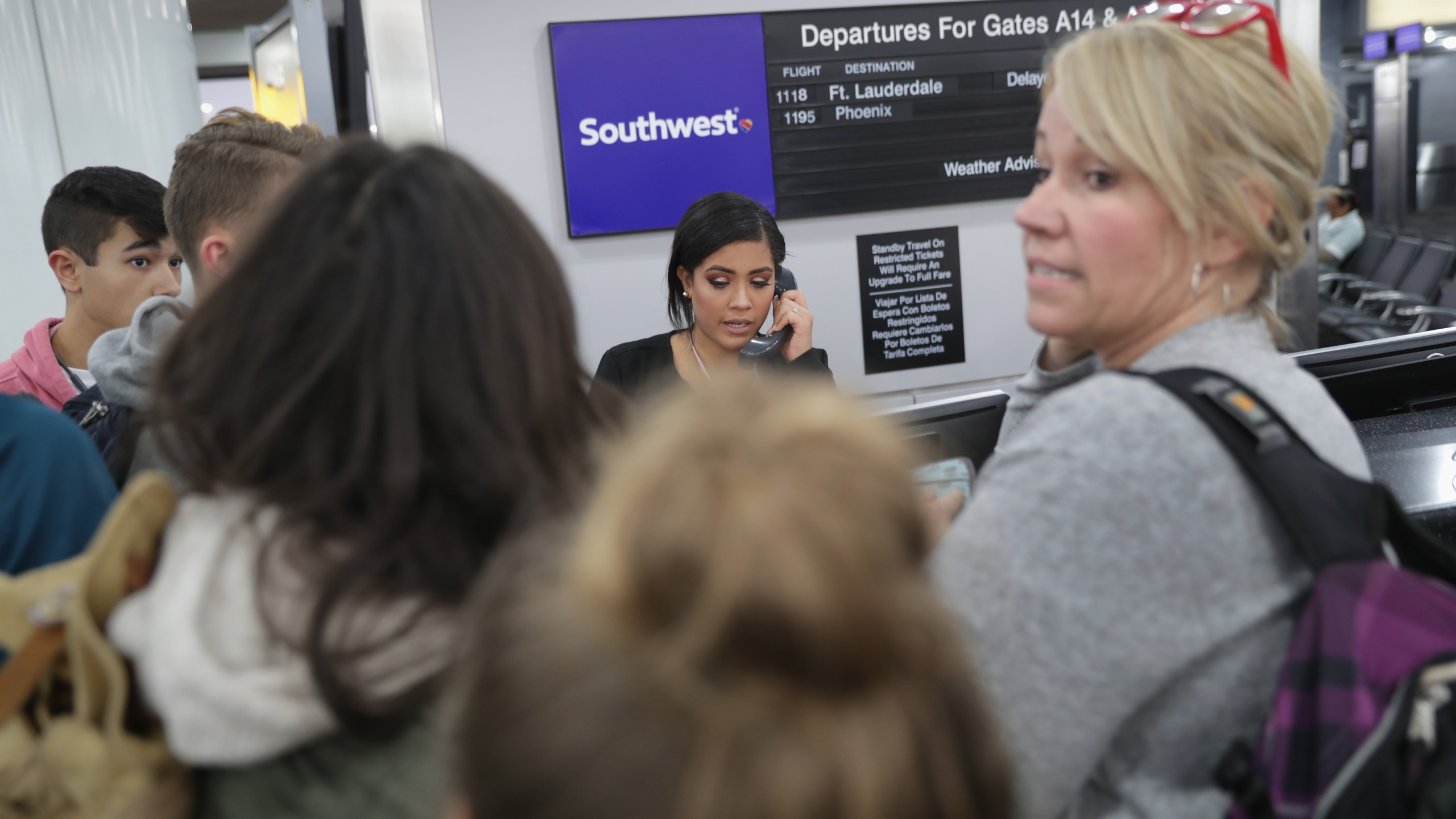 Passengers wait to rebook after their flights were cancelled due to a snow storm at the Newark Liberty International Airport on Nov. 15, 2018, in Newark, New Jersey. (Credit: John Moore/Getty Images)