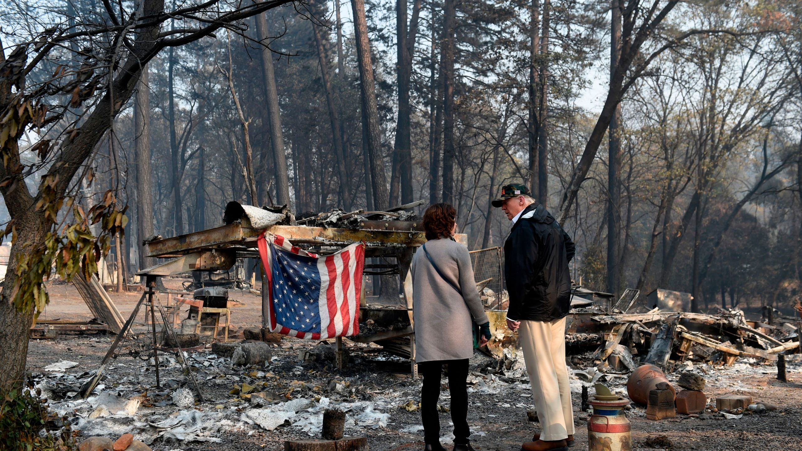 Donald Trump views damage from the Camp Fire in Paradise, California on Nov. 17, 2018. (Credit: SAUL LOEB/AFP/Getty Images)