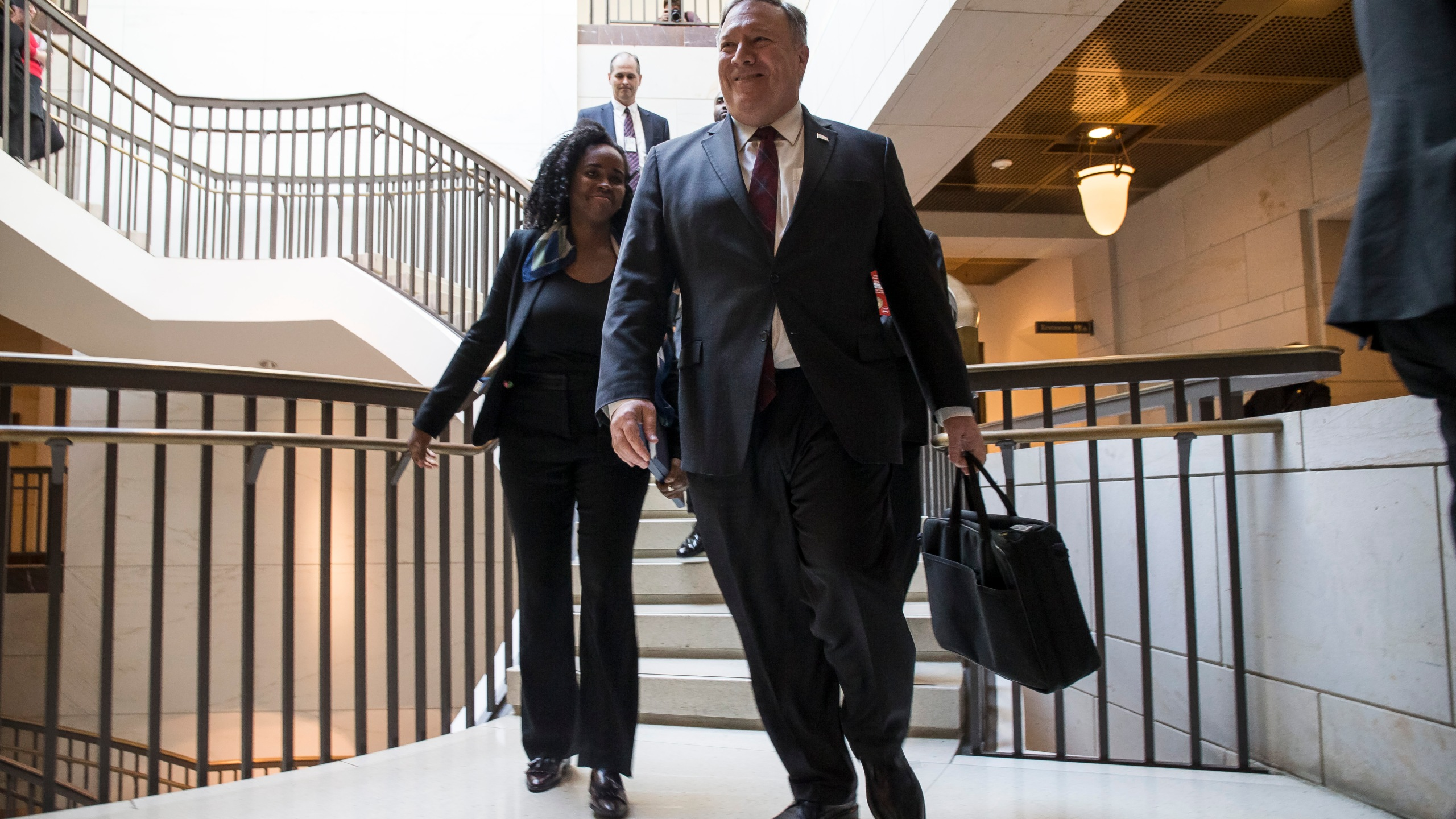 U.S. Secretary of State Mike Pompeo walks to a briefing with members of the Senate to discuss developments in Saudi Arabia on Nov. 28, 2018. (Credit: Zach Gibson/Getty Images)