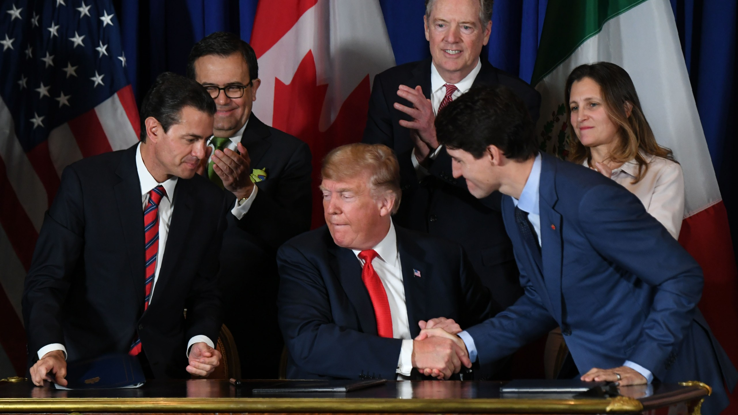 Mexican President Enrique Pena Nieto, US President Donald Trump and Canadian Prime Minister Justin Trudeau are pictured after signing a new free trade agreement in Buenos Aires, on Nov. 30, 2018, on the sidelines of the G20 Leaders' Summit. (Credit: Martin Bernetti/AFP/Getty Images)