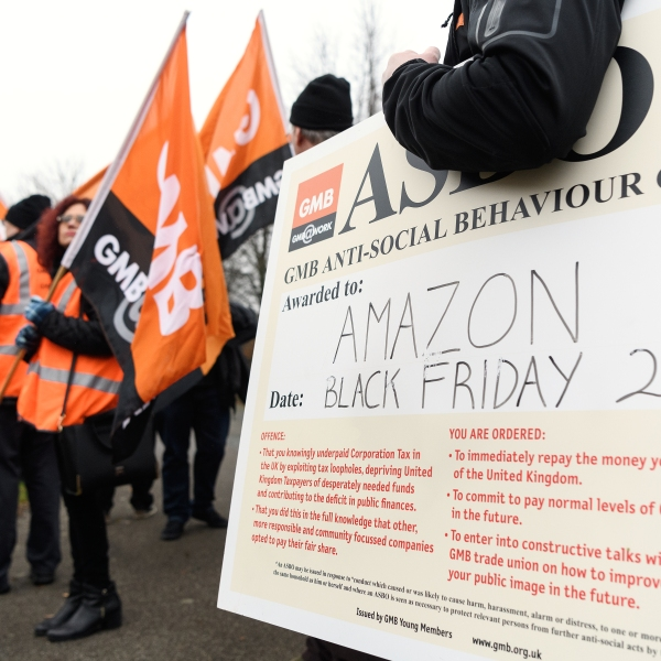 Members and supporters of the GMB union protest outside the Amazon offices as the company holds it's annual Black Friday sales, on November 23, 2018 in Milton Keynes, England. (Credit: Leon Neal/Getty Images)