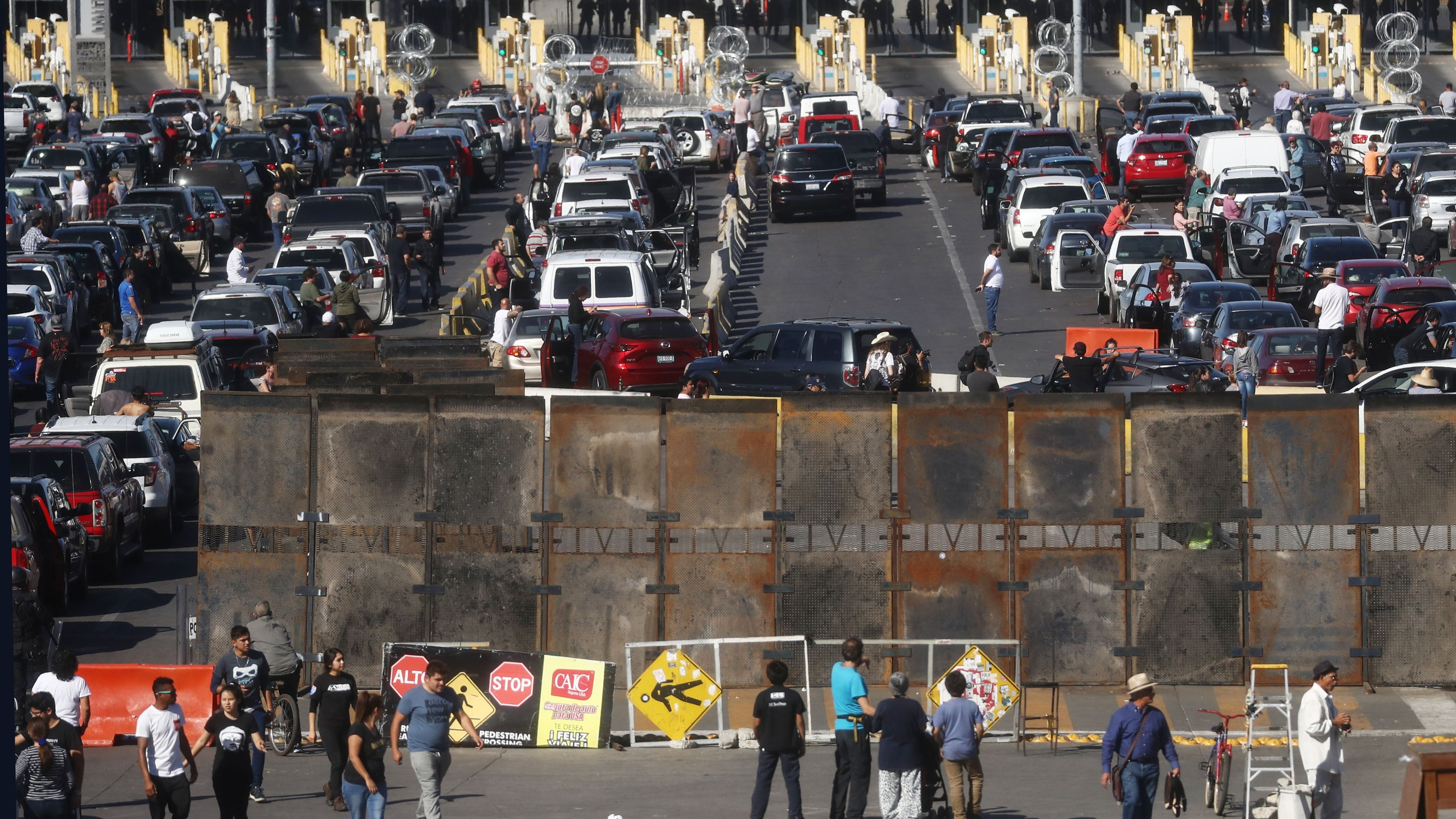 People attempting to cross in the U.S. look on as the San Ysidro port of entry stands closed at the U.S.-Mexico border on Nov. 25, 2018 in Tijuana, Mexico. (Credit: Mario Tama/Getty Images)