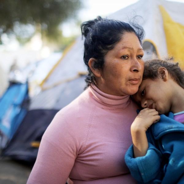 Honduran members of the 'migrant caravan' sit in a temporary shelter set up for members of the caravan on November 26, 2018 in Tijuana, Mexico. (Credit: Mario Tama/Getty Images)