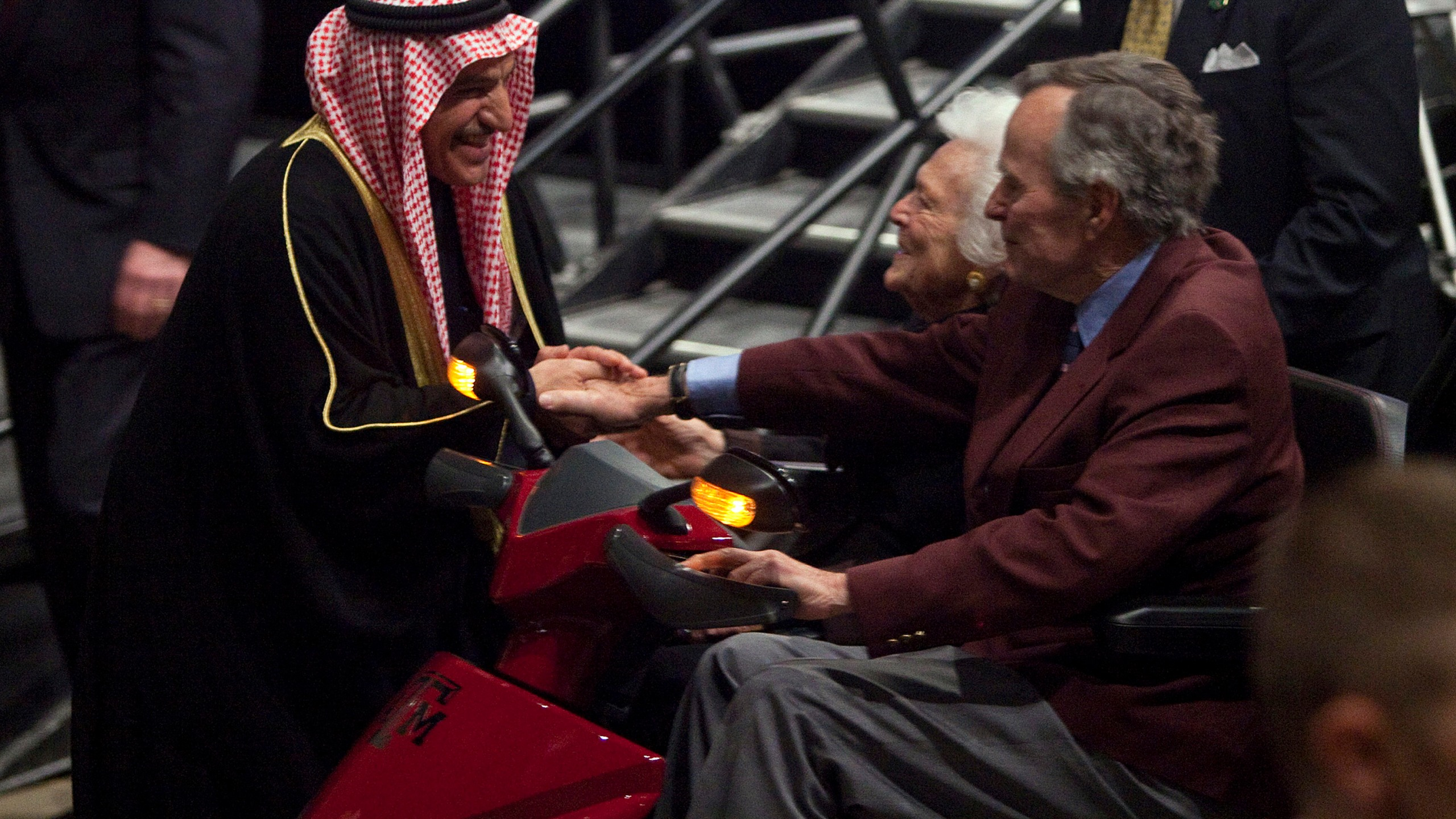 Former President George H. W. Bush (R) and first lady Barbara Bush (C) shake hands with His Excellency the Deputy Prime Minister of the State of Kuwait Sheikh Dr. Mohammad Sabah Al-Salim Al-Sabah after a panel discussion at an event honoring the 20th anniversary of the Persian Gulf War on January 20, 2011 in College Station Texas. (Credit: Ben Sklar/Getty Images)