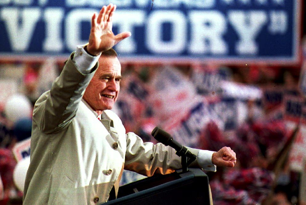 President George Bush waves to a group of supporters in November 1992 during a campaign stop in New Jersey. (Credit: J. DAVID AKE/AFP/Getty Images)