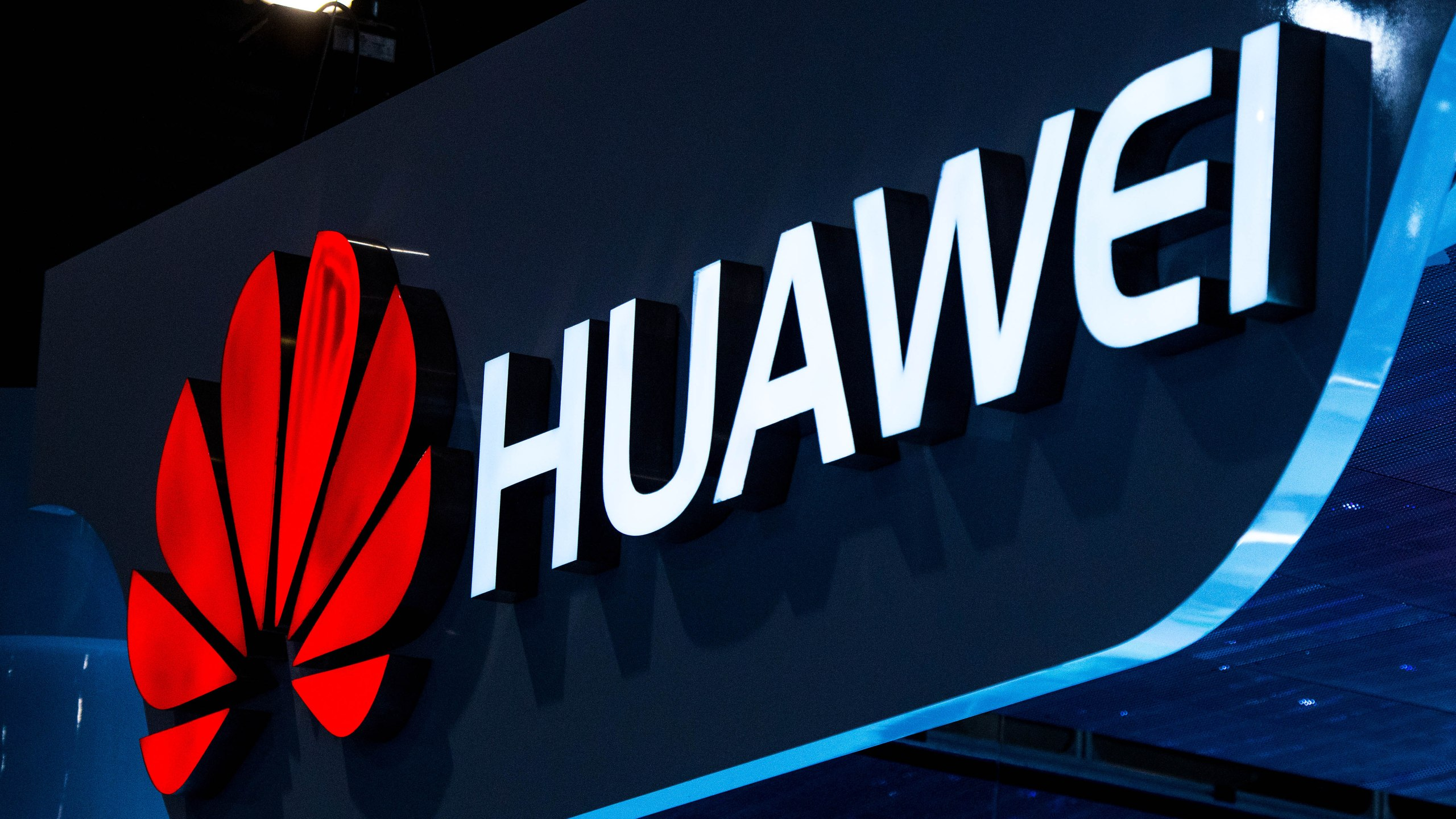 A logo sits illuminated outside the Huawei pavilion during the second day of the Mobile World Congress 2015 at the Fira Gran Via complex on March 3, 2015. (Credit: David Ramos/Getty Images)