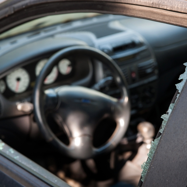 A broken car window is seen in a file photo. (Credit: iStock / Getty Images Plus)