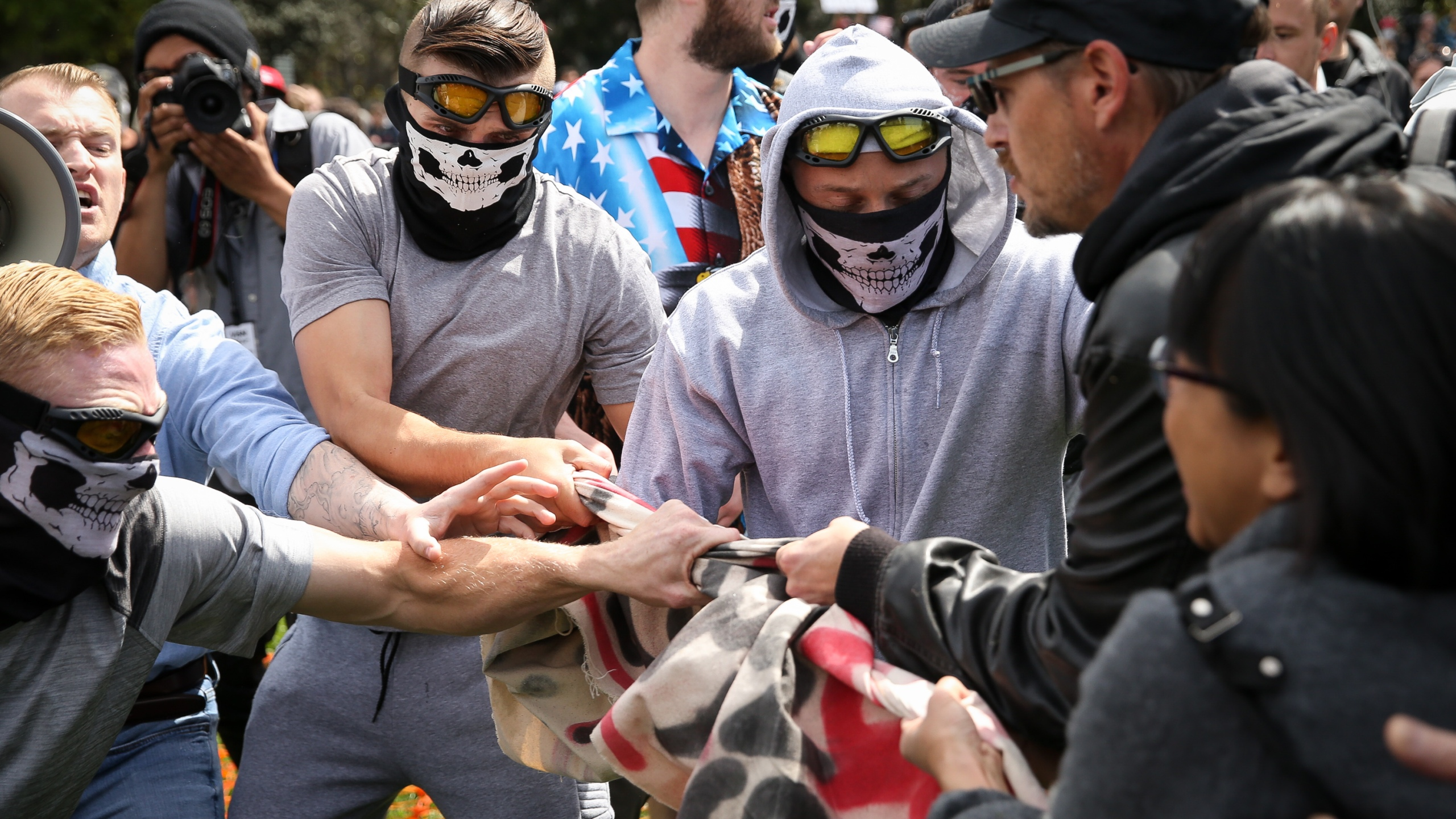 """Trump supporters clash with protesters at a """"Patriots Day"""" free speech rally on April 15, 2017 in Berkeley. (Credit: Elijah Nouvelage/Getty Images)"""