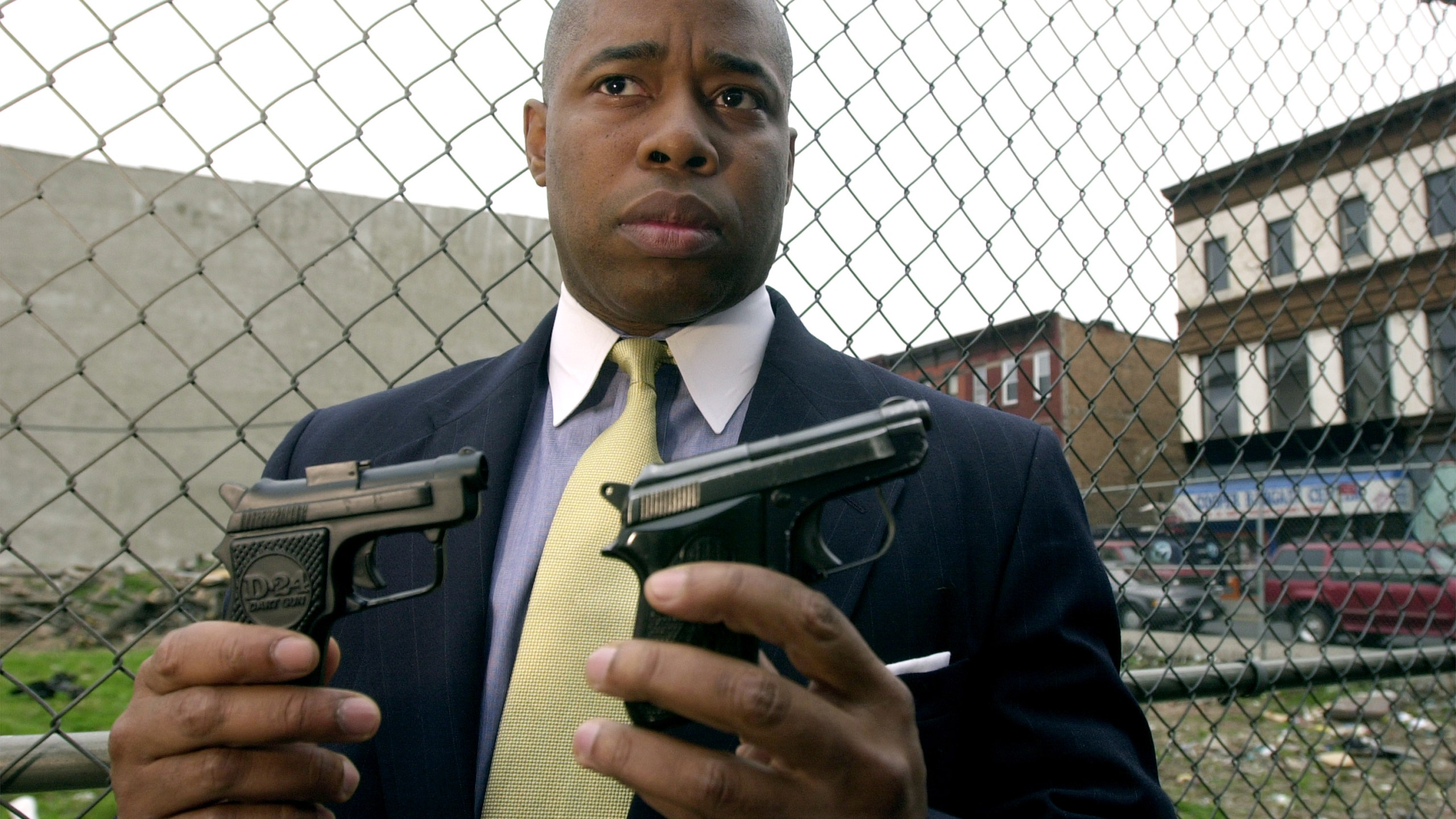 Eric Adams, a lieutenant in the New York Police Department and co-founder of 100 Black Men in Law Enforcement organization, holds up a toy gun, left, and a real gun to show the similarity between the two during a press conference in the Ocean Hill Brownsville neighborhood of Brooklyn. (Credit: by Chris Hondros)