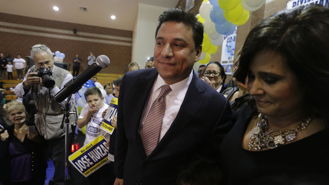 Los Angeles City Councilman Jose Huizar, with his wife Richelle Huizar, at his election night party in 2015. Richelle Huizar says she is ending her campaign for his seat. (Credit: Lawrence K. Ho / Los Angeles Times)