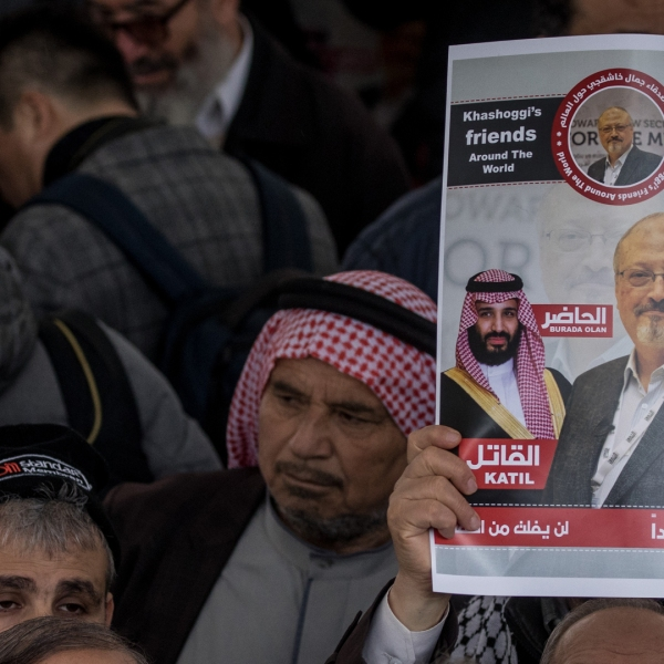 A man holds a poster showing a picture of Jamal Khashoggi after taking part in an absence prayer held after Friday pray at Fatih Mosque on Nov. 16, 2018, in Istanbul. (Credit: Chris McGrath/Getty Images)