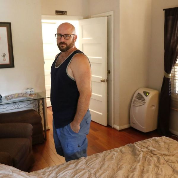 Marc Bochner, who lives in one of the apartments in the Westlake triplex that he owns, argues it would be unfair to ban him from hosting short-term rentals in his home just because his apartment falls under the Rent Stabilization Ordinance. (Credit: Mel Melcon/Los Angeles Times)