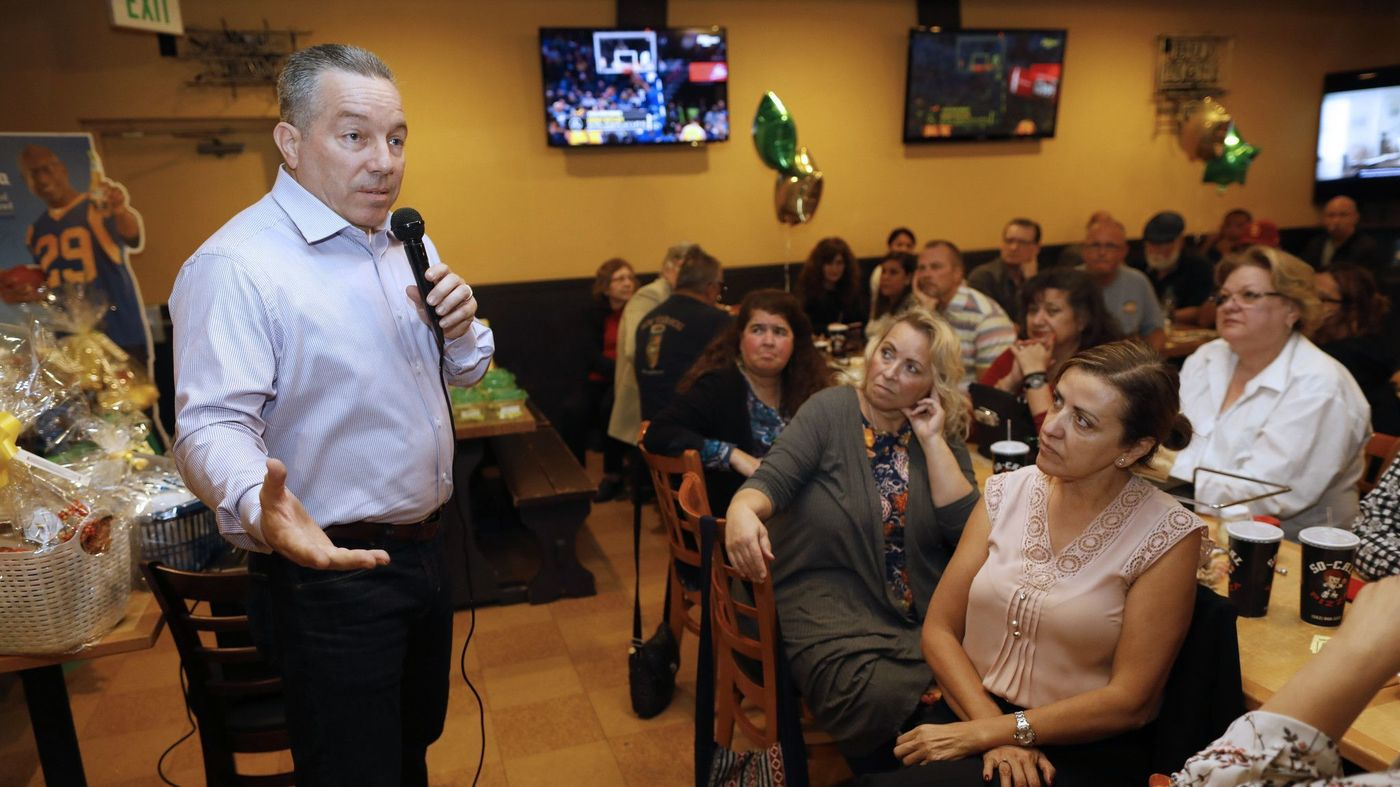 Alex Villanueva, the progressive candidate facing off with incumbent L.A. County Sheriff Jim McDonnell in the race for the leading law enforcement position is seen speaking to audience members in this 2018 photo. (Credit: Gary Coronado / Los Angeles Times)