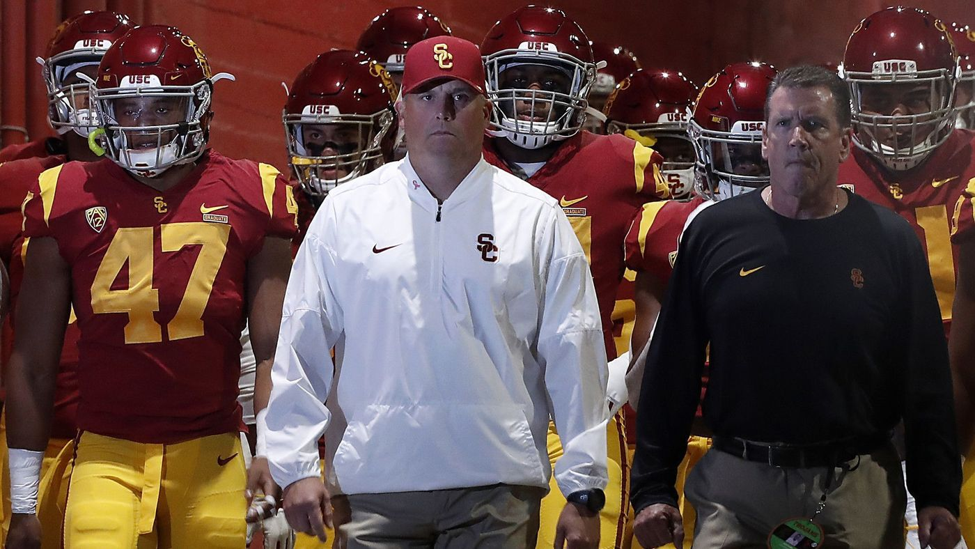 USC head coach Clay Helton leads the Trojans out of the tunnel for a game against Colorado. (Luis Sinco/Los Angeles Times)