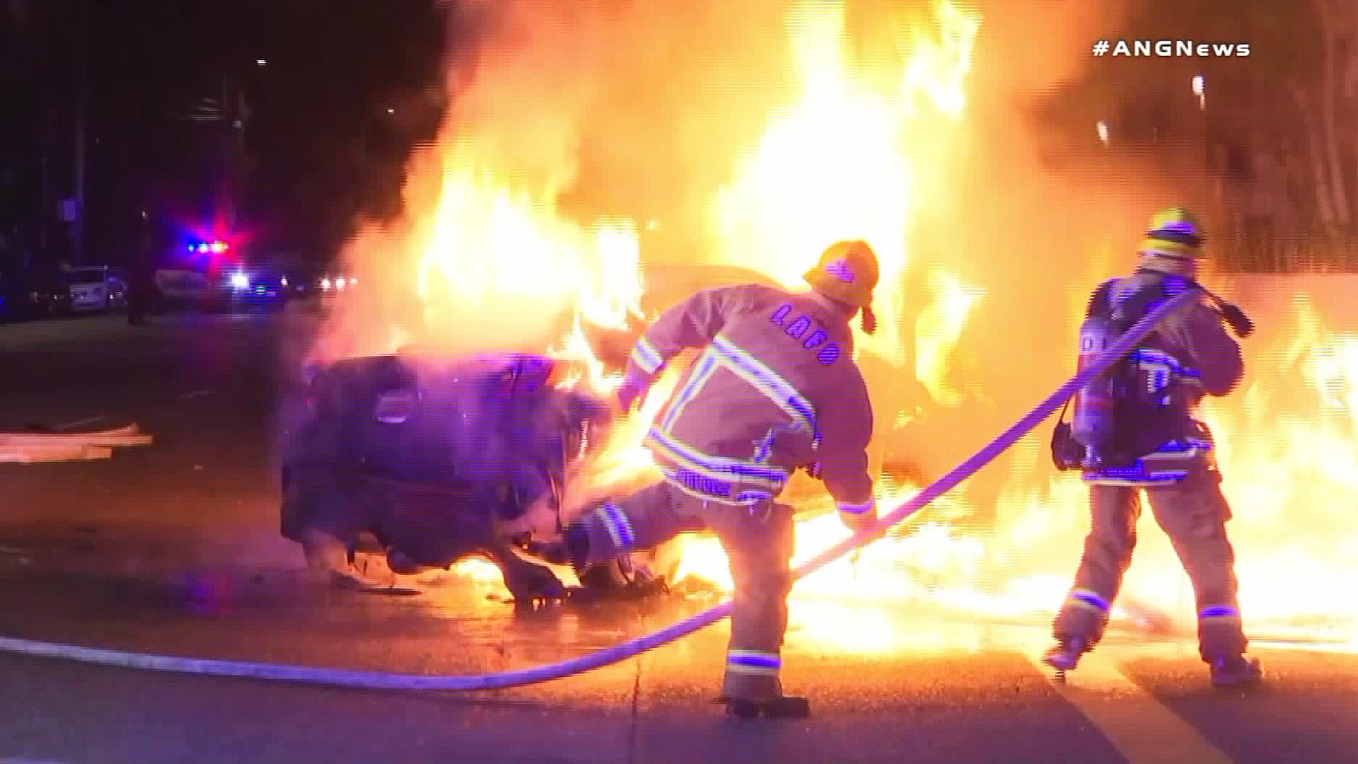 Crews respond to a car fire in Northridge on Nov. 19, 2018. (Credit: ANGNews)