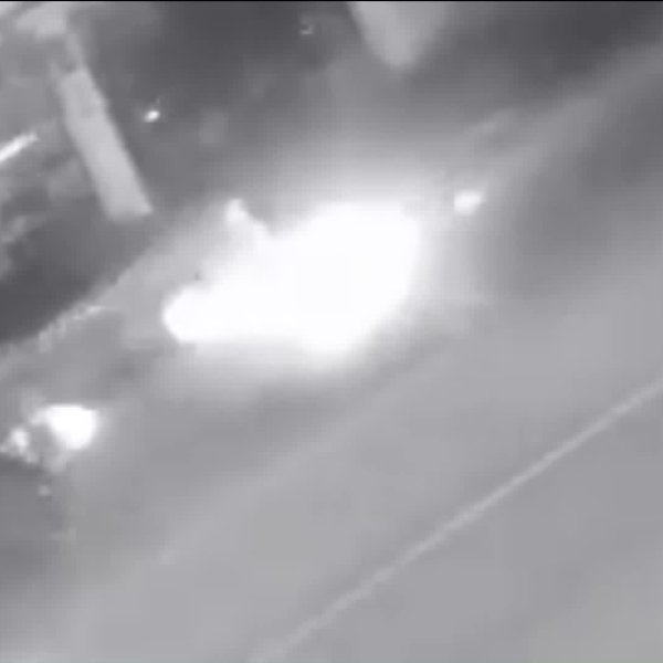 Los Angeles police are seeking the sedan pictured in this surveillance photo in connection with a deadly hit-and-run at Adams Boulevard and Burnside Avenue in the West Adams neighborhood on Oct. 26, 2018.