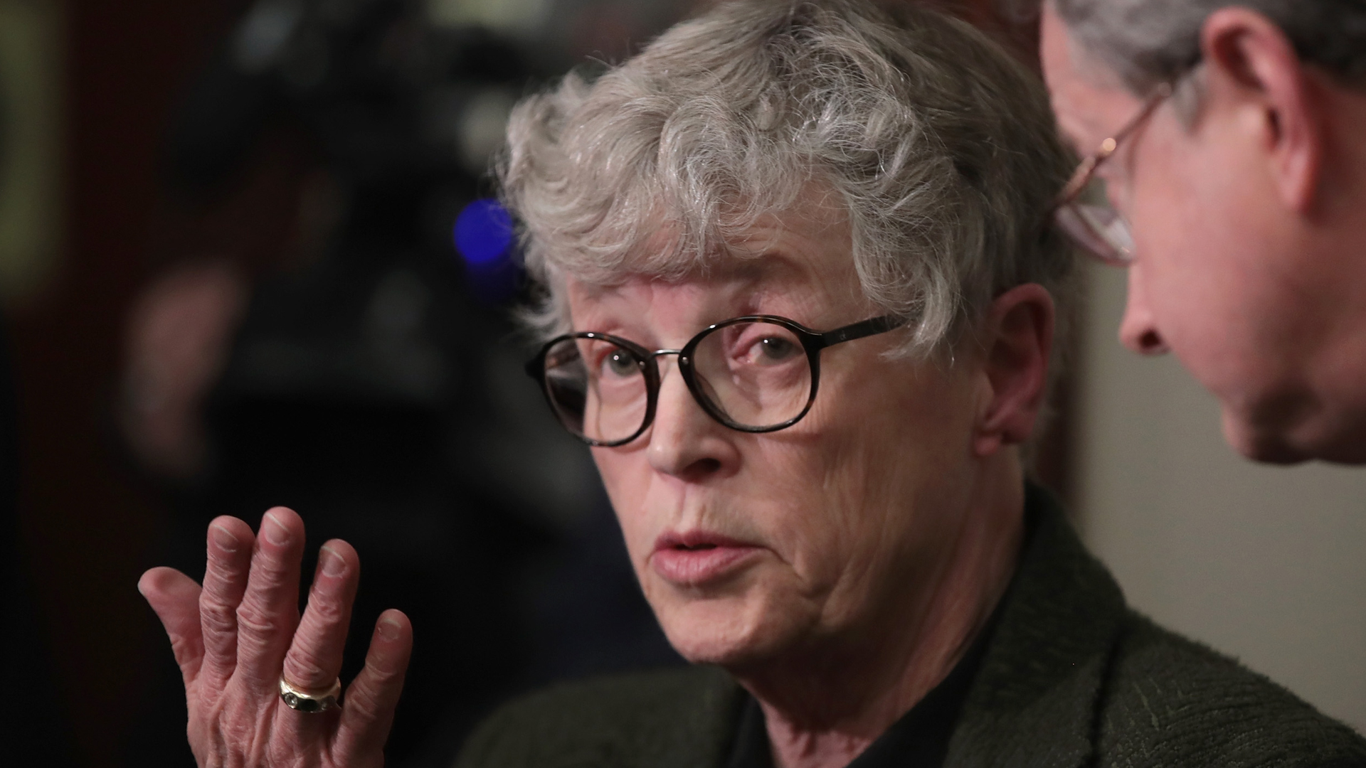 Former Michigan State University President Lou Anna Simon answers a question after being confronted by former MSU gymnast Lidsey Lemke during a break in the sentencing hearing for Larry Nassar who has been accused of molesting more than 100 girls while he was a physician for USA Gymnastics and Michigan State University where he had his sports-medicine practice on Jan. 17, 2018, in Lansing, Michigan. At the time, she was president of the university. (Credit: Scott Olson/Getty Images)
