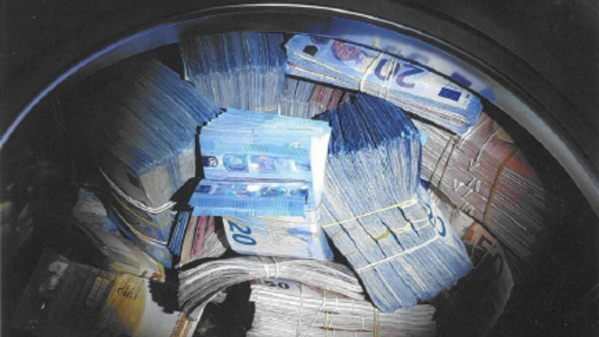 Police in Amsterdam arrested a man on suspicion of money laundering after finding about 350,000 euros, worth about $400,000, in a washing machine. (Credit: Netherlands National Police Corps)