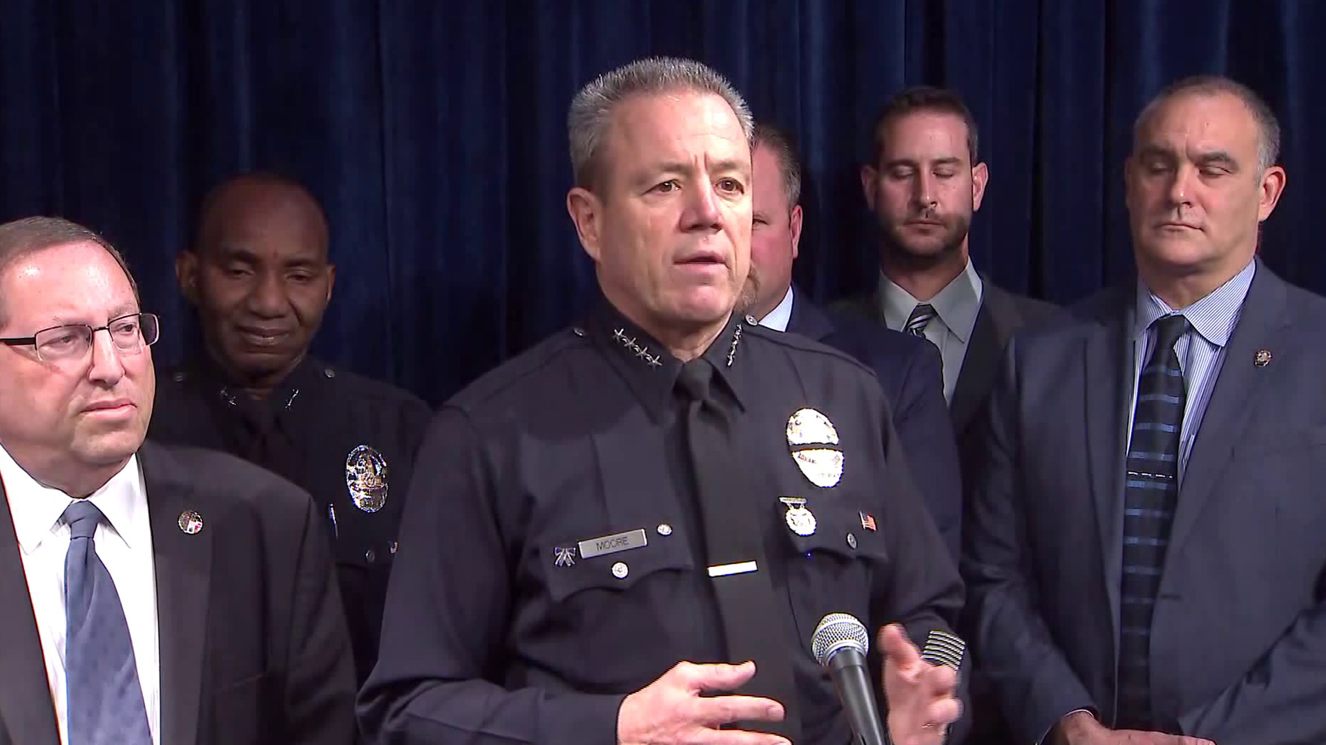 LAPD Chief Michel Moore (center) speaks during a news conference on Nov. 26, 2018. (Credit: KTLA)