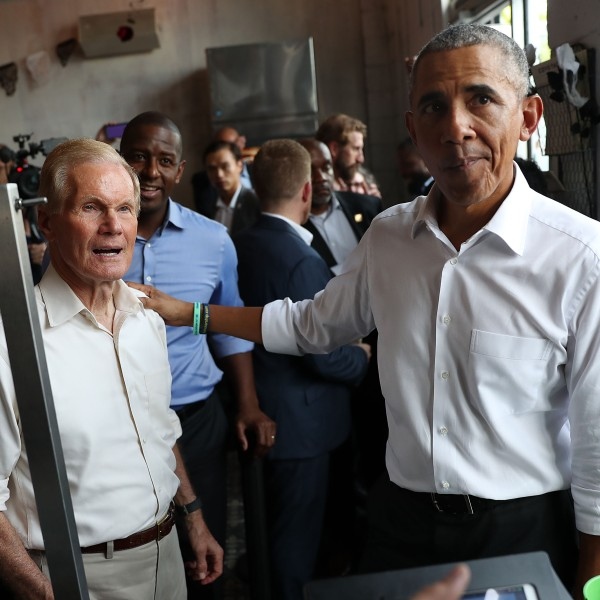 Former U.S. President Barack Obama orders lunch with U.S. Senator Bill Nelson (D-FL) and Florida Democratic gubernatorial candidate Andrew Gillum at the Coyo Taco restaurant on November 02, 2018 in Miami, Florida. (Credit: Joe Raedle/Getty Images)