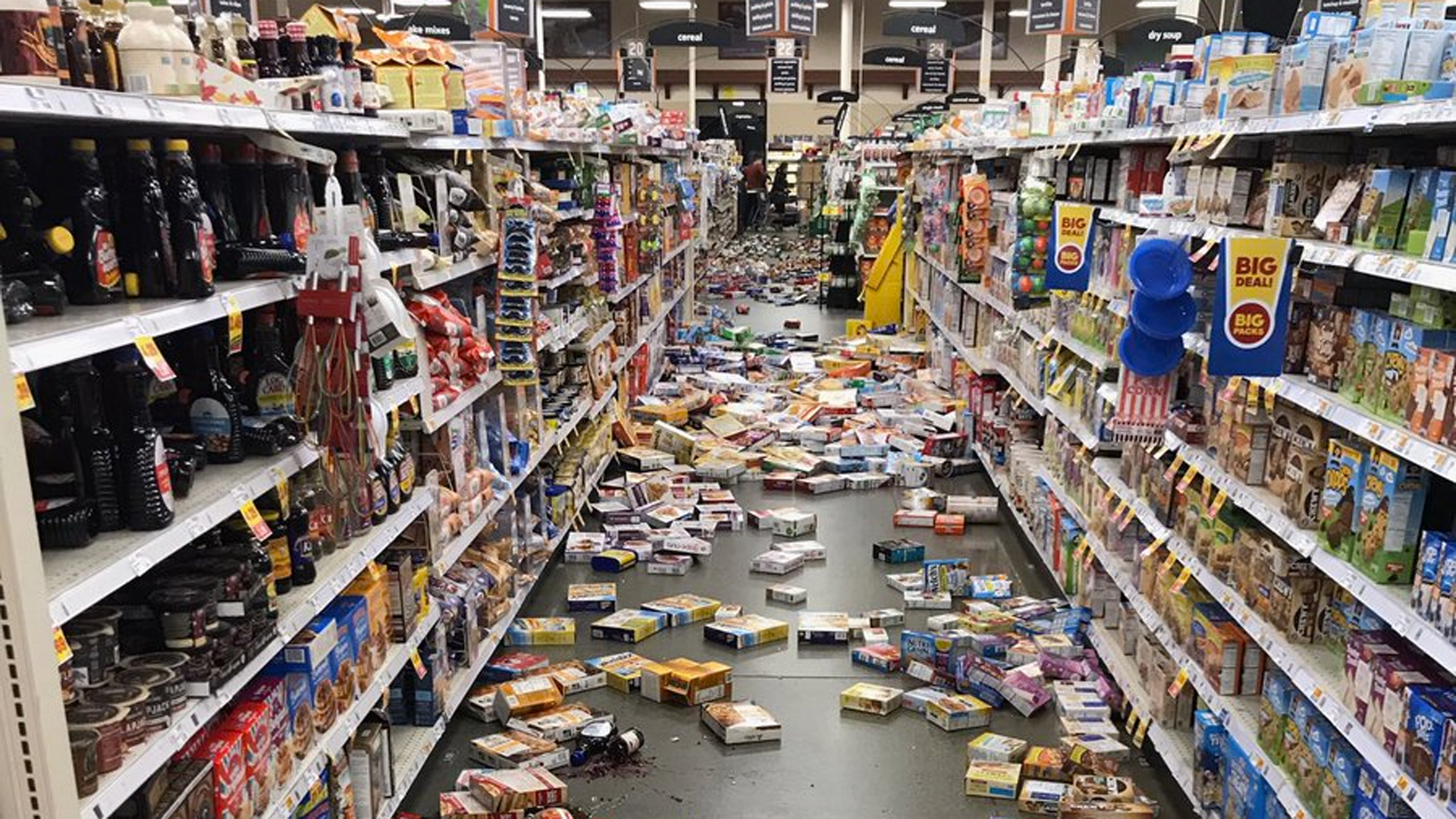 Damage at a grocery store is seen in an image provided by @eg_brownson via Twitter.