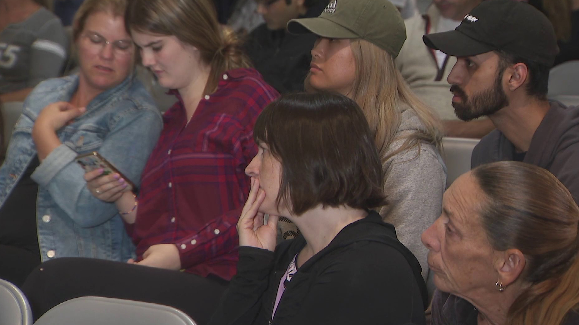 Residents watch a town hall in Woodland Hills on the Woolsey Fire on Nov. 11, 2018. (Credit: KTLA)