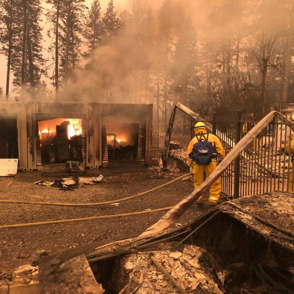 House and car damaged in Paradise, California from the Camp Fire on Nov. 8, 2018. (Credit: Nick Valencia/CNN)