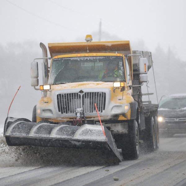 A plow clears snow from in Douglas County, Kansas, Sunday. (Credit: Associated Press via CNN Wire)